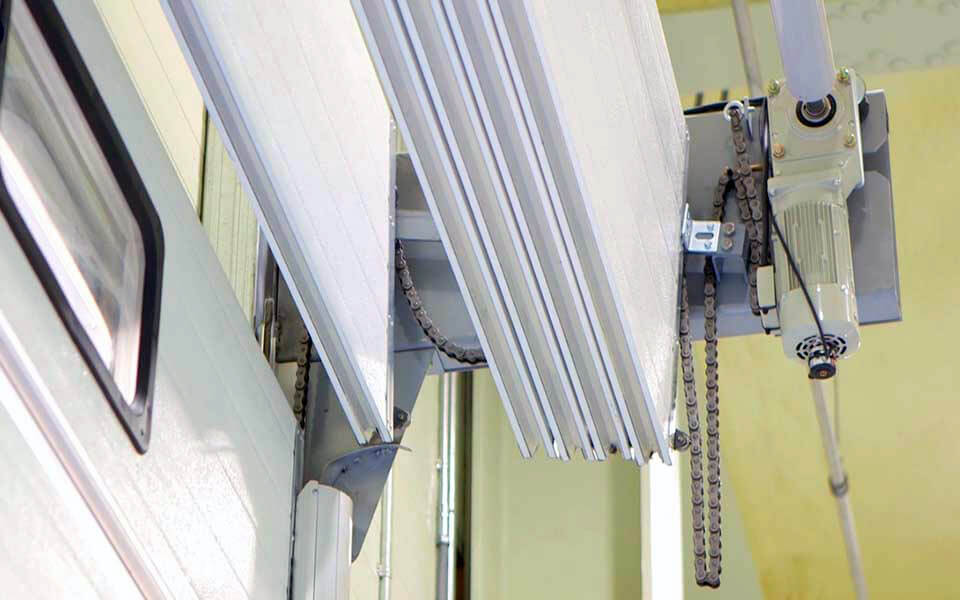 Stacking overhead door operating